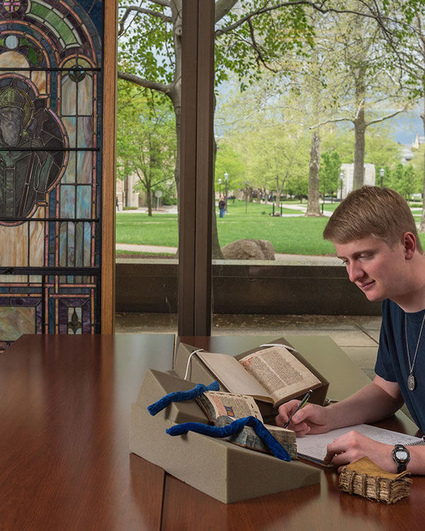 Luke Donahue viewing manuscripts from Rare Books and Special Collections at the Hesburgh Library